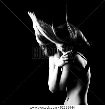 Fashion girl. Young beautiful woman with long blond hair fly-away, b&w