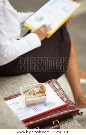 Businesswoman Eating Sandwich