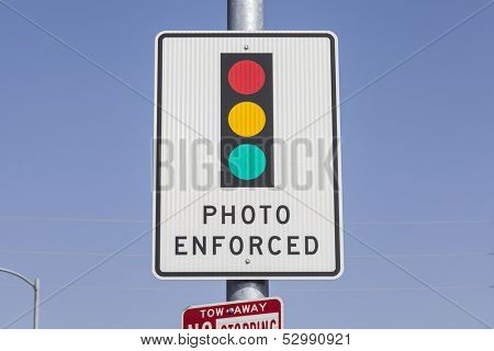 Photo enforced traffic light warning sign.