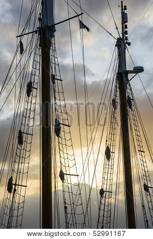 Sailship poles in the setting sun