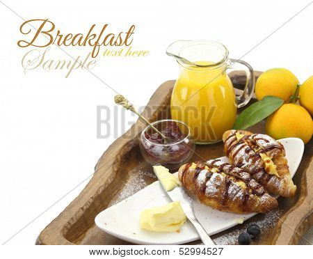 Breakfast with croissants and beverages on tray