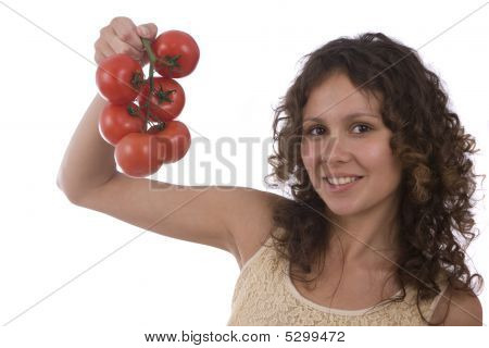 Pretty Smiling Woman Holding Branch Of Red Tomatoes.
