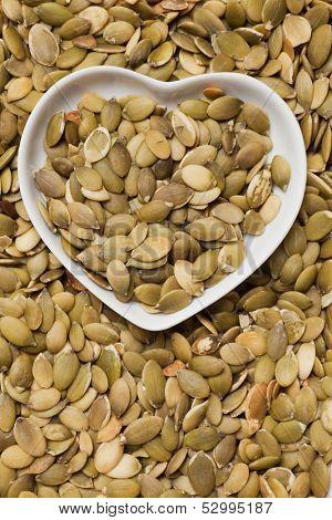 Pumpkin seed, healthy snack in heart shaped tray
