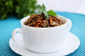 stock photo of porridge  - Lentil porridge with carrots and fresh parsley - JPG