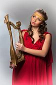 picture of tunic  - cute girl in a red tunic with a harp - JPG