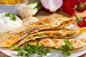 stock photo of southwest  - Southwest beef quesadila served with fresh chilli peppers and sourcream.