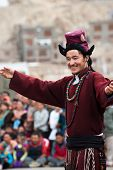Tibetan Man Performing Folk Dance. India