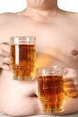 pic of beer-belly  - Color photo of a large belly and a mug of beer - JPG