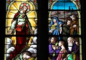 picture of atonement  - stained glass window, jesus and believers