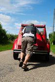 stock photo of breakdown  - man is having a car breakdown in France - JPG