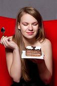 pic of pie-in-face  - a Cheerful woman eating chocolade a pie - JPG