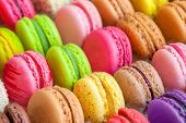 stock photo of biscuits  - traditional french colorful macarons in a rows in a box - JPG