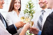 pic of flute  - Portrait of smart colleagues with flutes of champagne wishing you Merry Christmas - JPG