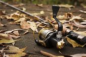 foto of spinner  - This is Fishing tackle on wooden weathered surface - JPG