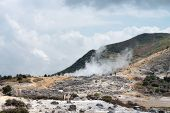 stock photo of plateau  - Smoking volcanic Sikidang crater Dieng plateau Java Indonesia - JPG