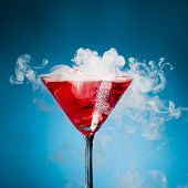 image of chemical reaction  - red cocktail with ice vapor - JPG