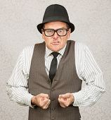 stock photo of insulting  - Insulted white male with eyeglasses clenching fists - JPG