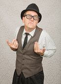 stock photo of headstrong  - Upset white businessman with hat and eyeglasses - JPG