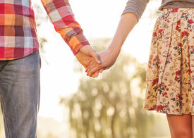 image of jeans skirt  - Young couple in love walking in the autumn park near the river - JPG