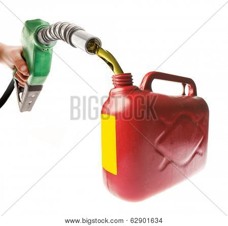 Male hand pouring gasoline in a red canister with a green nozzle on white