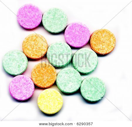 Orange, Green, Pink, Yellow Antacid Isolated White Background.