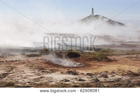 Iceland. Reykjanes Peninsula. Gunnuhver Geothermal Area. Boiling Water And Steam Emerging. Lighthous