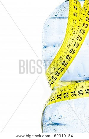Half Plastic Bottle With Water, Drops And Measuring Tape, Concept Of Nutrition And Diet