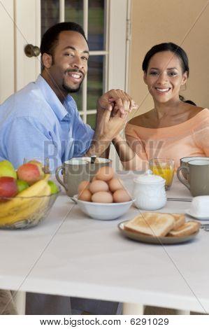 Happy African American Couple Sitting Outside Having A Healthy Breakfast
