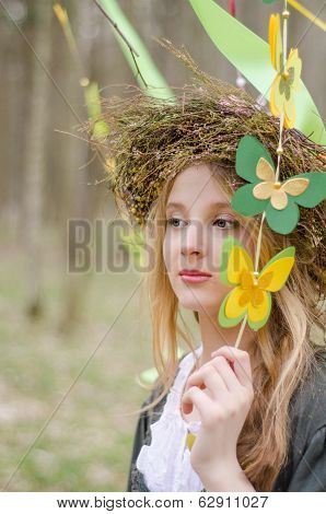 Close Up Portrait Of A Girl In A Circlet Of Flowers Holding Garland Of Butterflies