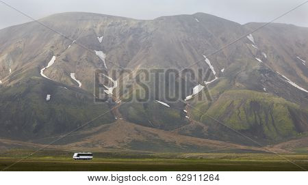 Iceland. South Area. Fjallabak. Volcanic Landscape With Rhyolite Formations And Bus.