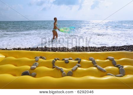 From Stones I You Love An Inscription On Yellow Air Matrass On Beach, Beautiful Woman With Fabric
