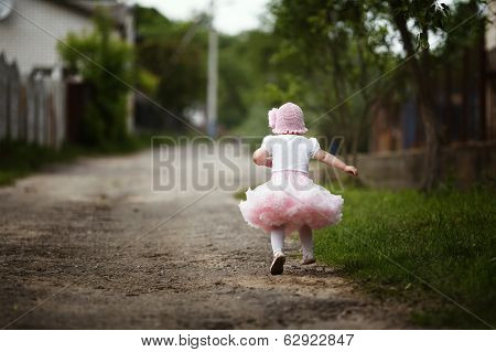 little girl in dress running away
