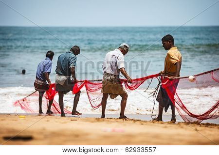 Bentota, Sri Lanka - 26 Apr 2013: Sri Lankan Fishermen Pull Big Net In Bentota, Sri Lanka. Fishing I