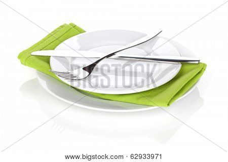 Silverware or flatware set of fork and knife over plates. Isolated on white background