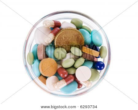 Fifty Euro Cents In Saucer Full Of Pills