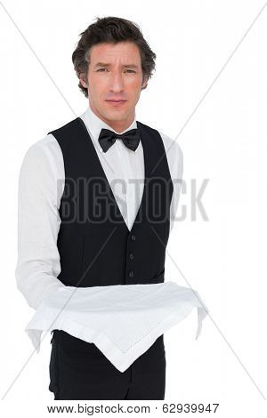 Portrait of confident server holding tray against white background