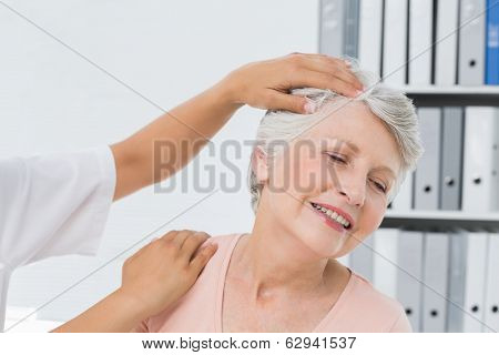 Close-up of hands doing neck adjustment in the medical office
