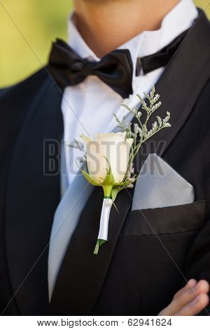 Close-up mid section of beautiful flowers on lapel of male