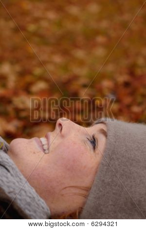 Beautiful Young Woman Looking Up At Copy Space