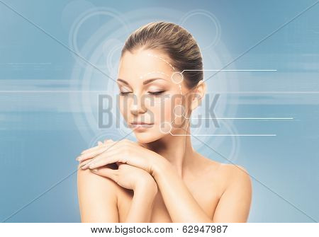 Close-up portrait of young, fresh and natural woman with the dotted arrows (spa, surgery, face lifting and make-up concept)