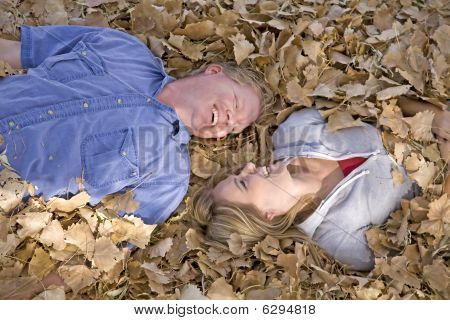 Man And Woman In Leaves Close