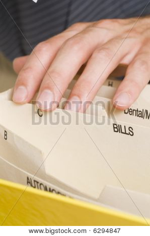 Man Filing Bills