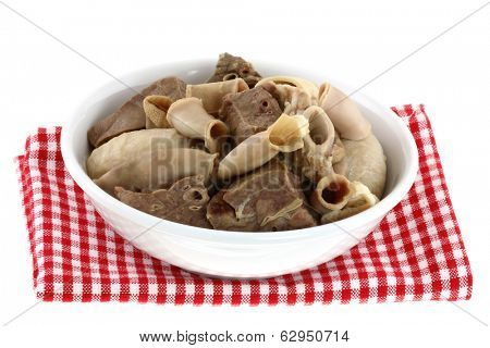 A bowl of Fresh Chitterlings (Pork intestines) and other Entrails on a Checkered table cloth, isolated on a white background