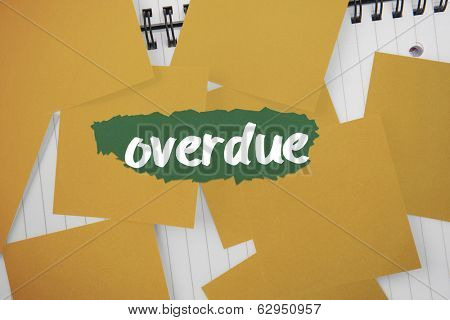 The word overdue against yellow paper strewn over notepad