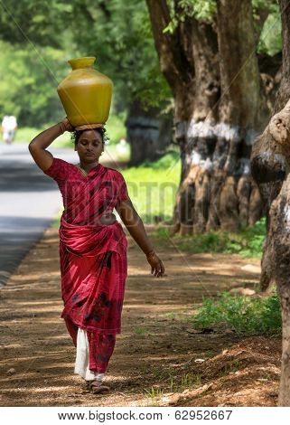 Indian Woman Carries Pot Of Water On Her Head.