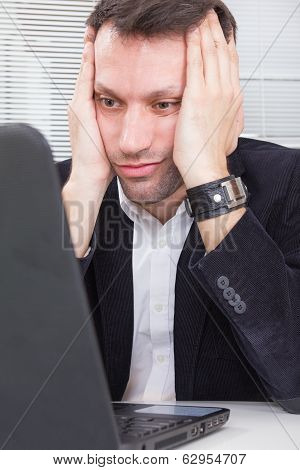 Business Man Looking At Screen Laptop Computer With A Shocked Upset Expression