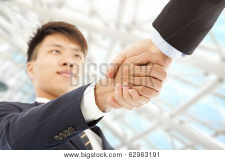 Two Businessman Shaking Hands Greeting Each Other