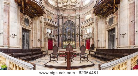 Mafra, Portugal - September 02, 2013: Altar and apse of the Basilica of the Mafra Palace and Convent. Franciscan religious order. Baroque architecture.