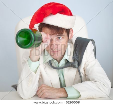 Drunk Man In Christmas Cap Plays With Bottle