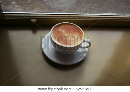 Latte in sunlit window